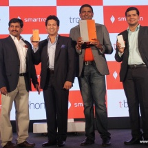 (L-R Narsi Reddy,Co-Founder & Managing Director, legendary cricketer Sachin Tendulkar, Mahesh Lingareddy, Founder & Chairman, Rohit Rathi, Co-Founder & President unveiling the tbook and the tphone)